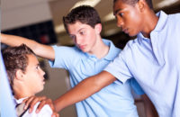 Teens bullying a younger child