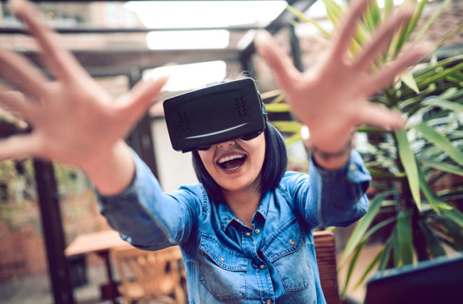 Woman gaming wearing virtual reality headset