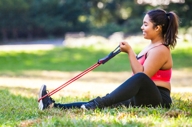 Woman using resistance band for training