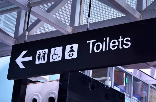 Sign for public restrooms at airport