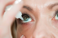Woman using eye drops to relieve dry eyes