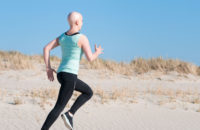 Cancer patient running on the beach