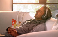 Man relaxing listening to music on couch