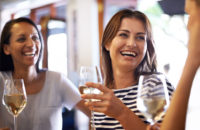 Pregnant woman out with friends at bar drinking alcohol