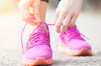Woman putting on her new walking shoes