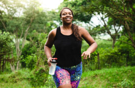 woman with asthma runs in the park