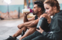 Man and women taking advantage of pre-workout drinks