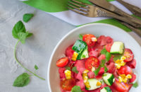 Watermelon salad with corn, tomatoes and cucumbers