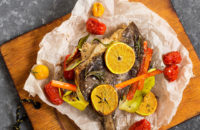 Flounder baked in parchment with veggies and lemon