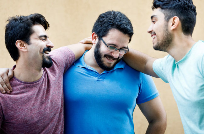 three friends with beards laughing