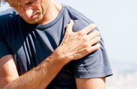 Man experiencing shoulder pain due to impingement