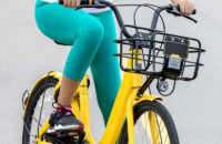 Closeup of woman riding bike focused on her knee