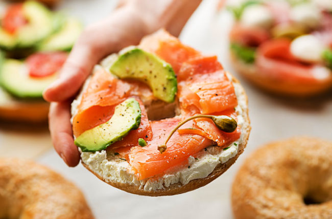 healthy bagel with vitamin D rich salmon on top
