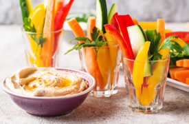 A healthy snack of hummus and raw vegetables