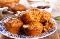 Muffins on a plate containing chai, pumpkin and apples
