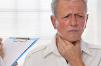 Older man at doctors office worried about lymph nodes in neck