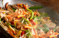 Chicken stir fry with snow peas, cabbage and peppers