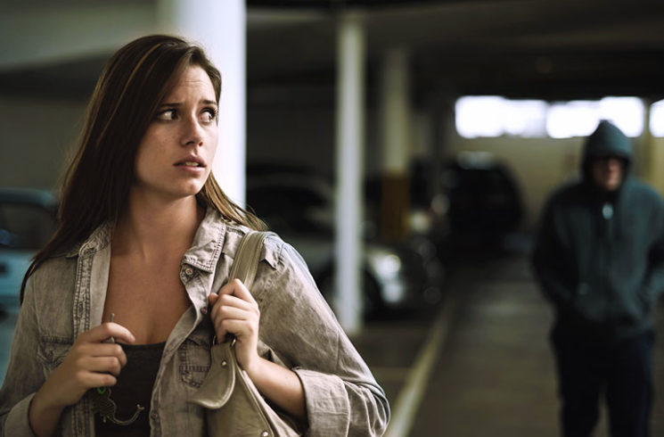 woman frightened in parking lot by stranger