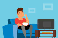 Man watching TV and having a snack