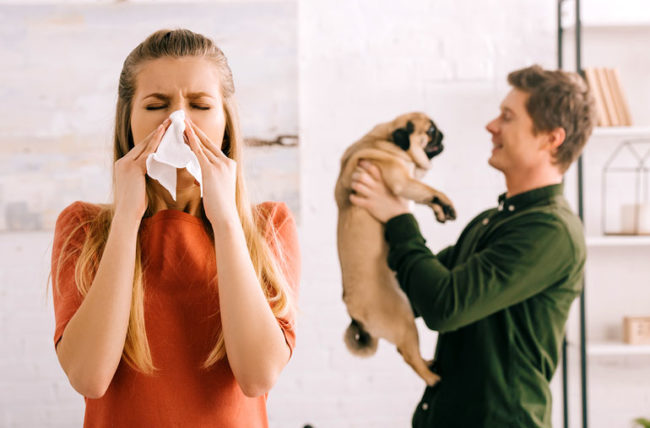 Woman allergic to dog being held by man