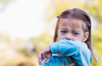 A little girl coughing in to get elbow : Stock Photo Buy the print Comp Save to Board A little girl sneezing in to get elbow