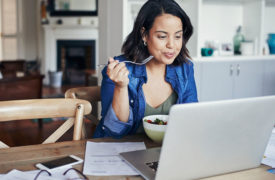 woman eats healthy while working from home