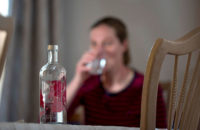 woman drinking alcohol at home
