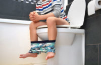 child on toilet in bathroom