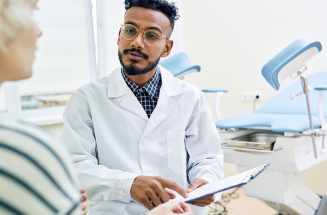 woman taking to doctor at gynecology appointment