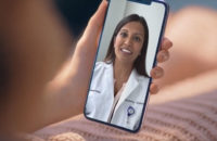 patient during a virtual visit with her doctor