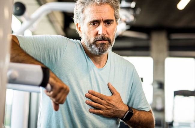 Older man exercising gets muscle pain in chest