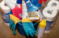 Cleaning supplies in a bucket