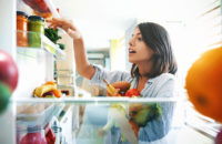 woman raiding the fridge on the weekend