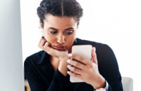 unhappy woman scrolling on smartphone