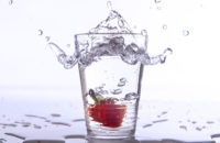 water with a strawberry in it
