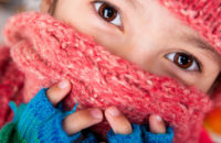 child wearing scarf over face in winter