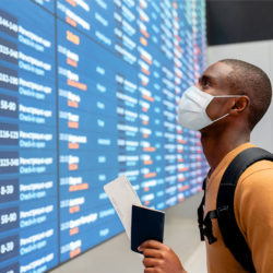 man with mask traveling in airport during pandemic