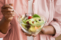 older woman eating a healthy salad