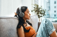 empathy fatiuged woman relaxing by listening to music