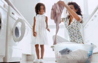 woman daughter doing laundry together
