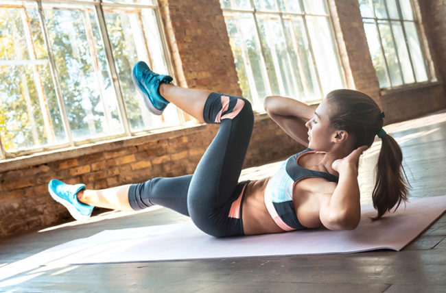 woman doing bicycle crunches for her abdominals