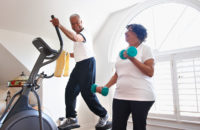 elderly husband and wife exercise at home