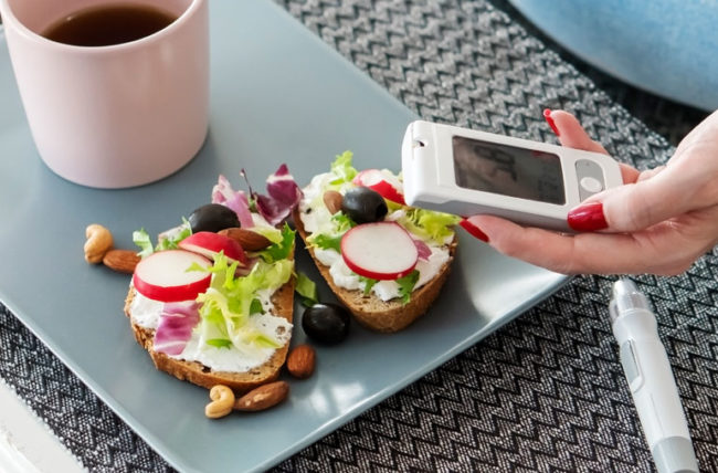 woman eating healthy and checking her insulin levels
