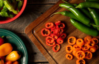 spicey peppers on chopping block