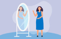 woman looking at image in mirror